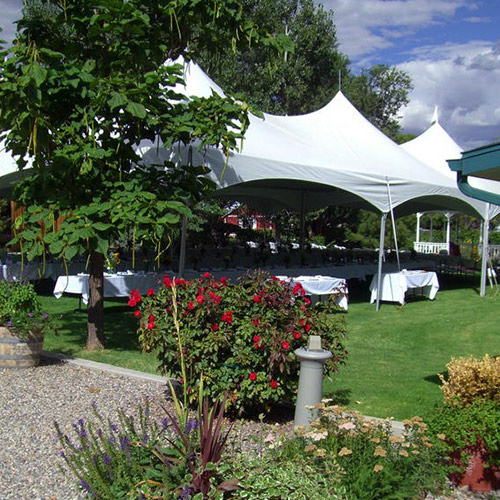 large tables under a very large tent at Amy's Courtyard in Palisade Colorado